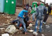 ATTENTION EDITORS - VISUAL COVERAGE OF SCENES OF DEATH AND INJURY Mozambique national Emmanuel Sithole is attacked by men in Alexandra township during anti-immigrant violence in Johannesburg April 18, 2015. He later died of his injuries. Zimbabwean President Robert Mugabe on Saturday expressed shock and disgust at attacks on immigrants in neighbouring South Africa and said his government was working to bring back home affected Zimbabwean citizens. At least four people have been killed in a wave of anti-immigrant violence in South Africa that started two weeks ago in the port city of Durban and spread to Johannesburg. REUTERS/James Oatway/Sunday Times ATTENTION EDITORS - FOR EDITORIAL USE ONLY. NOT FOR SALE FOR MARKETING OR ADVERTISING CAMPAIGNS. THIS IMAGE HAS BEEN SUPPLIED BY A THIRD PARTY. IT IS DISTRIBUTED, EXACTLY AS RECEIVED BY REUTERS, AS A SERVICE TO CLIENTS. NO ARCHIVES. NO SALES. NO ONLINE USE. SOUTH AFRICA OUT. NO COMMERCIAL OR EDITORIAL SALES IN SOUTH AFRICA TPX IMAGES OF THE DAY